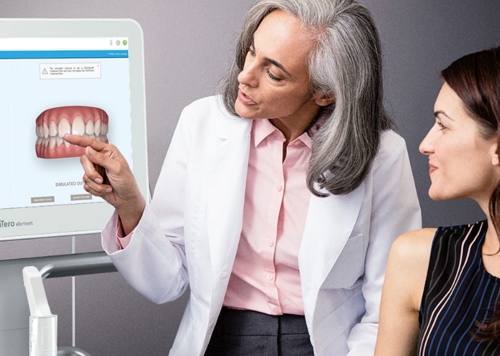 Dentist discussing itero scans with patient